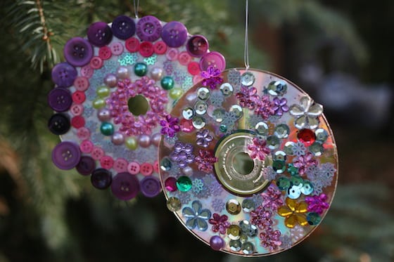 2 cd ornaments decorated with craft gems