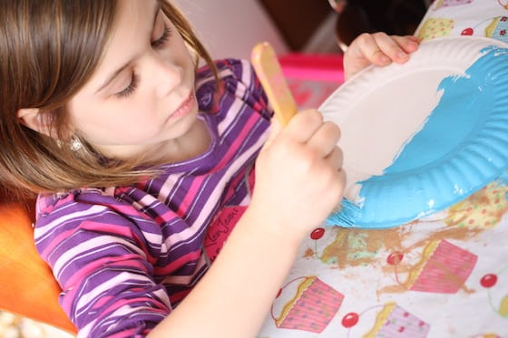 child painting paper plate