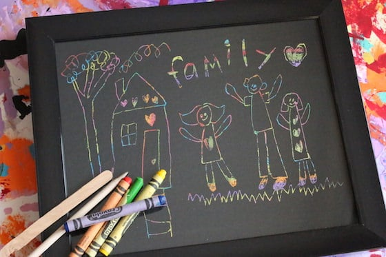 crayons craft sticks and scratch art drawing in black frame