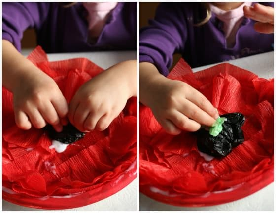 gluing centre on crepe paper poppy craft