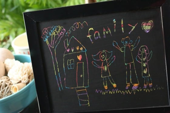scratch art family portrait by child