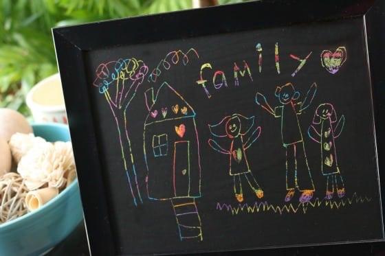 scratch art family portrait by child