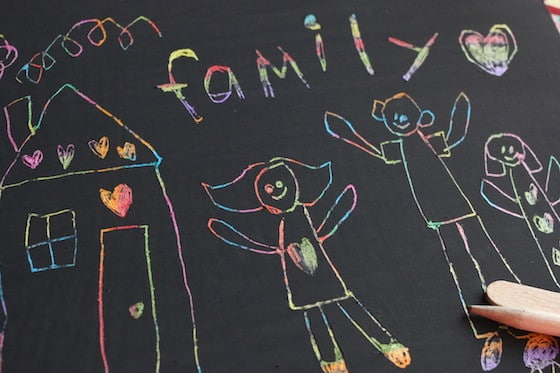 scratch art family portrait drawn by child