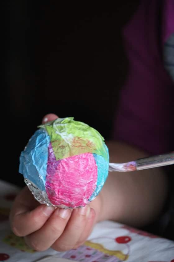 gluing tissue paper to tin foil ball