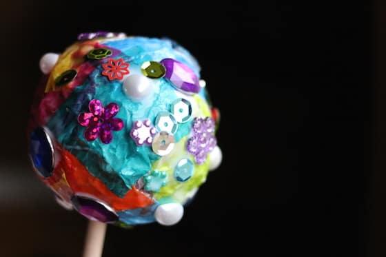 tinfoil tissue ornament on craft stick