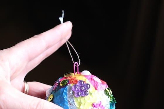 using paper clip as hanger for homemade christmas ornament