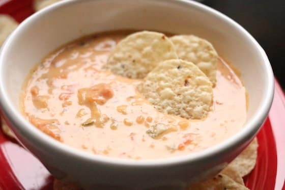Warm Cheese Dip with tomatoes, velveeta, old white cheddar and jalepeno peppers