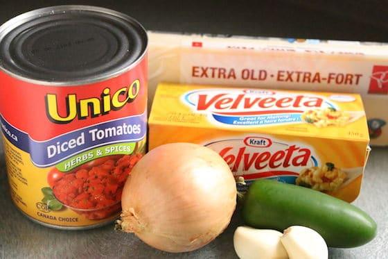 onion, garlic, velveeta, old white cheddar, jalepeno pepper, diced tomatoes