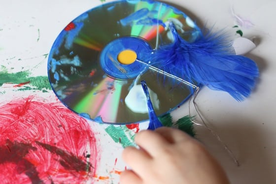 gluing craft feathers on a cd