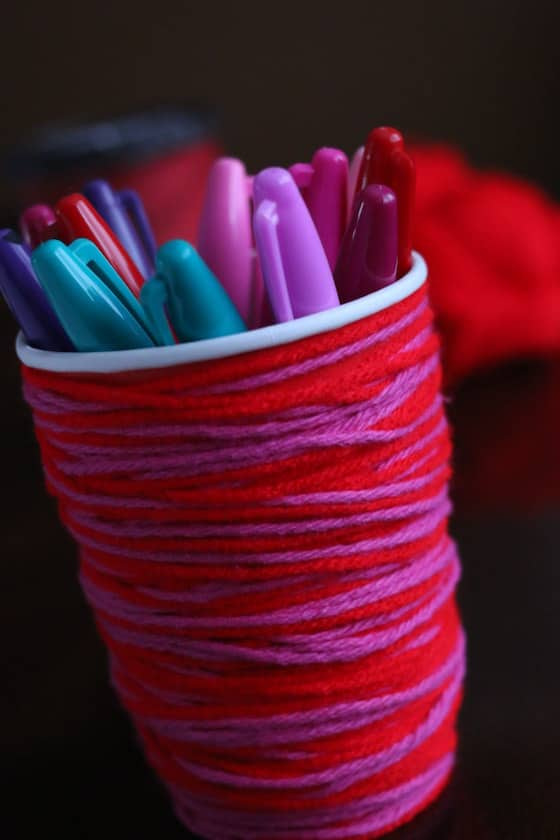 Sharpie markers in wool-wrapped coffee cup pen holder