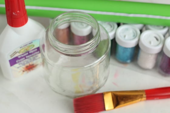 glass jar, glitter, paintbrush, glue, contact paper