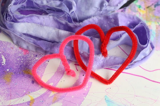 2 heart shaped pipe cleaners and fabric strips