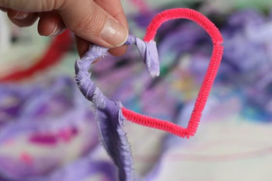 wrapping fabric strip around pipe cleaner heart
