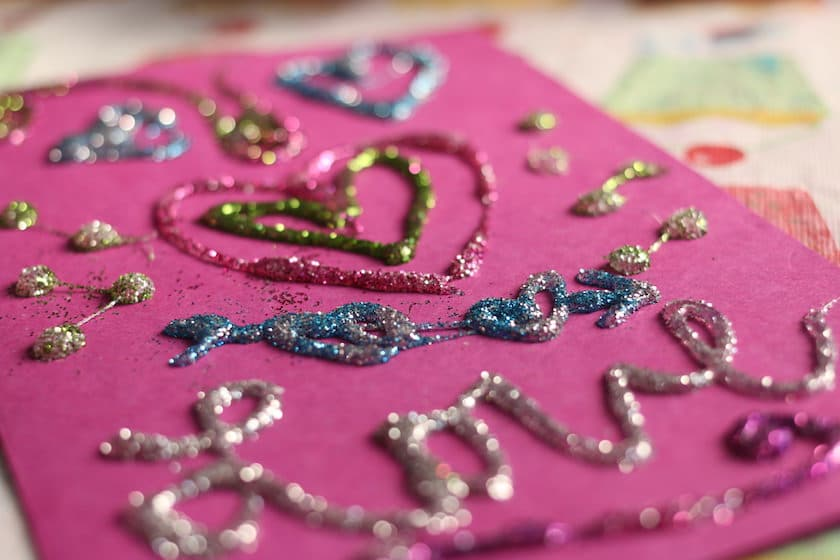 Homemade valentines card with hot glue and glitter
