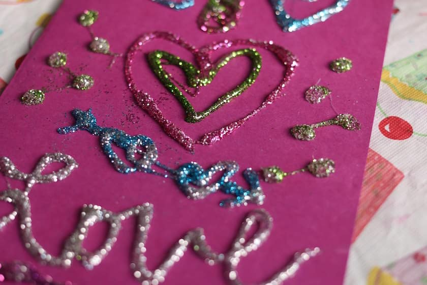 3-D designs made with glue guns and glitter