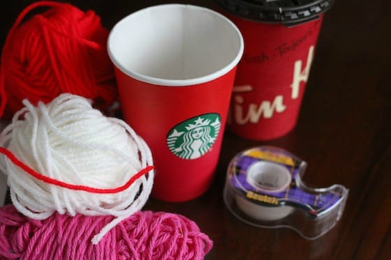 Take-out coffee cups, yarn, tape