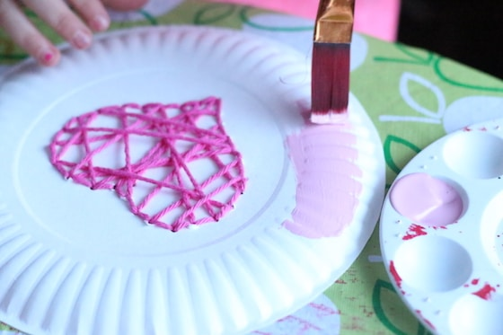 child painting a paper plate & Paper Plate Yarn Weaving - Sewing Hearts - Happy Hooligans