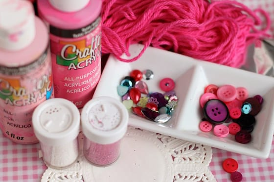pink paint, glitter, pink yarn, doilies, red and purple buttons