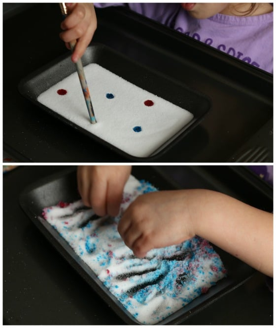 Adding food colouring to the salt tray