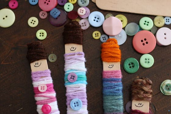 Craft stick dolls and buttons