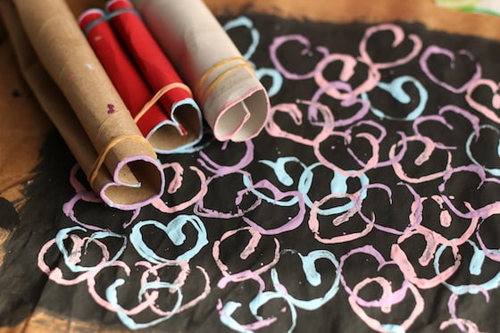 cardboard rolls shaped into hearts and stamped painting