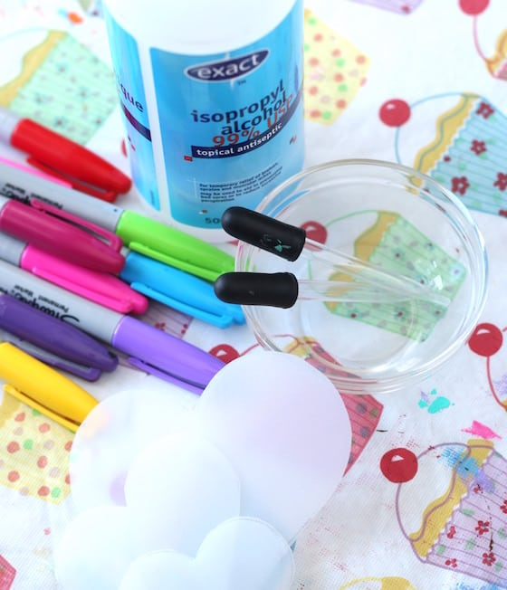 sharpies, 99% rubbing alcohol, hearts cut out of plastic vinegar container