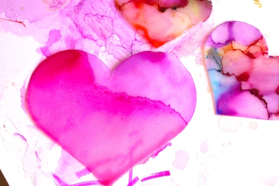 hearts coloured with sharpies and dripped with rubbing alcohol