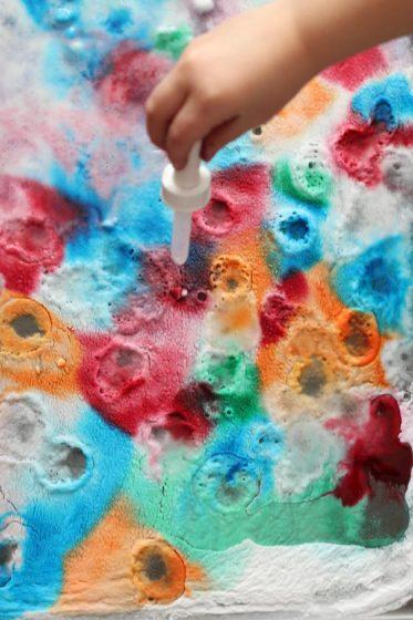 dripping vinegar onto food colour in baking soda