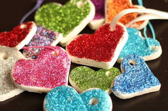 pile of glittered white clay dough heart ornaments