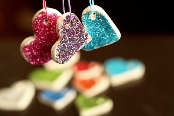 red, blue and multicoloured glitter ornaments made from baking soda clay heart ornaments
