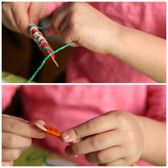 wrapping popsicle sticks with yarn