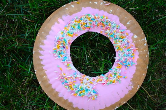 finished paper plate donut with icing and sprinkles