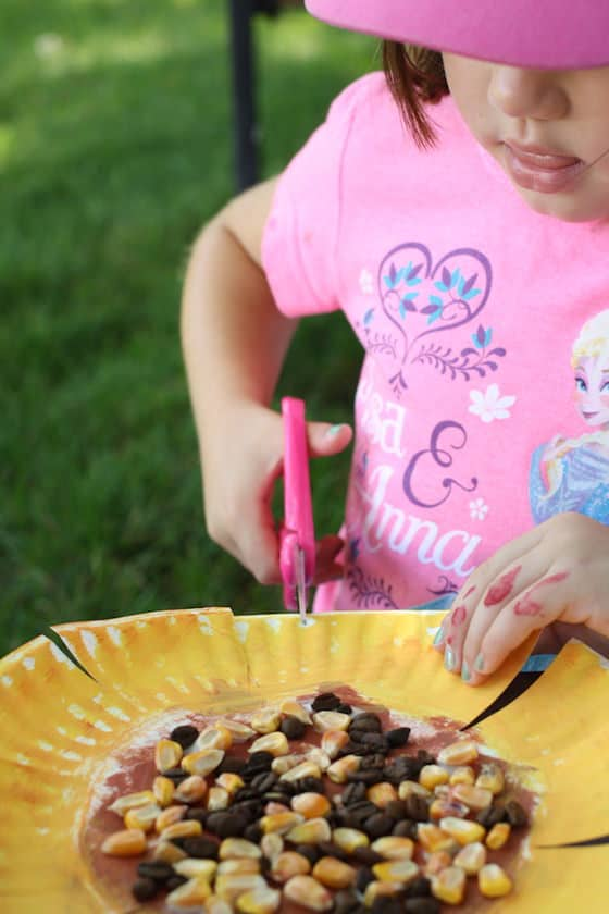child cutting paper plate & Paper Plate Sunflower Craft for Preschool - Happy Hooligans