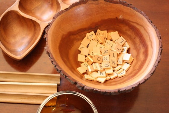 wooden bowl filled with scrabble tiles