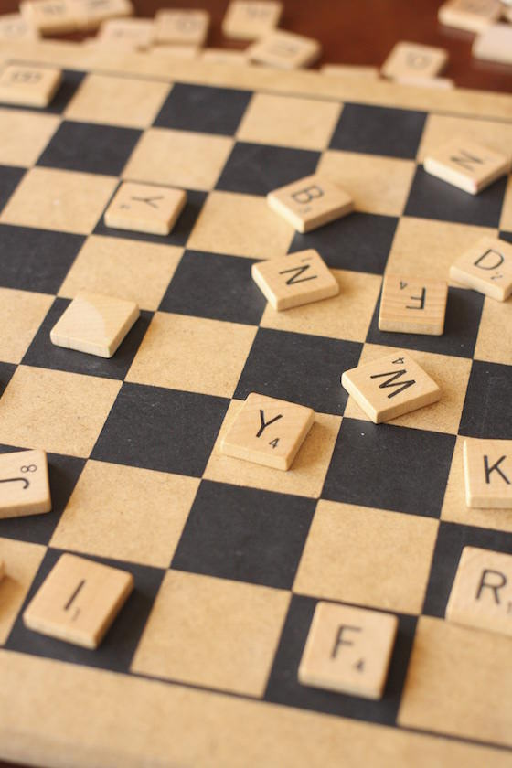 preschoolers playing with scrabble tiles on a checkerboard