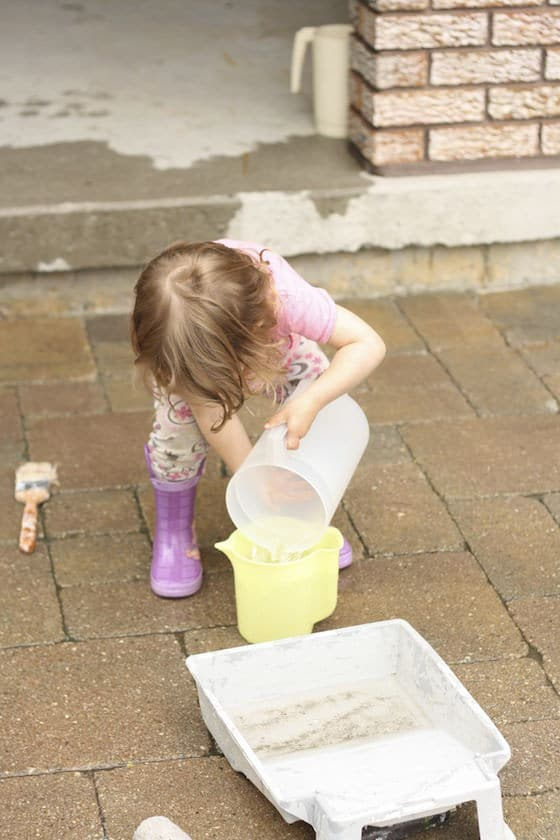 child pouring water