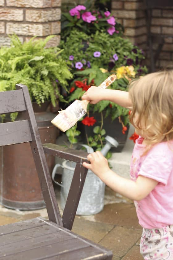 child painting chair with water
