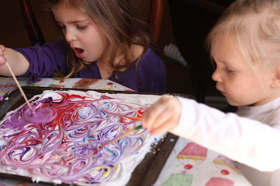 preschoolers making marbled paper with shaving cream and food colouring