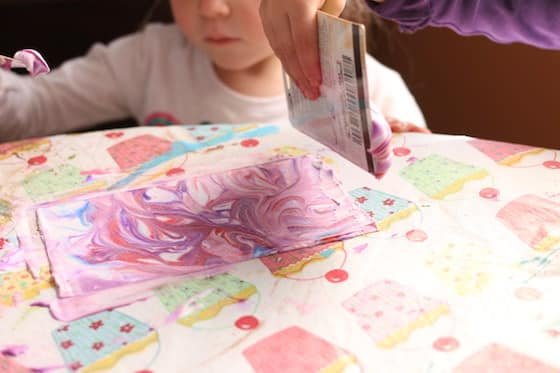 marbled effect on paper made with shaving cream and food colouring