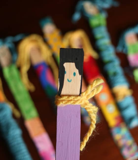 Paint stick doll with painted