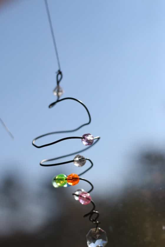 beads on wire spiral in the sun