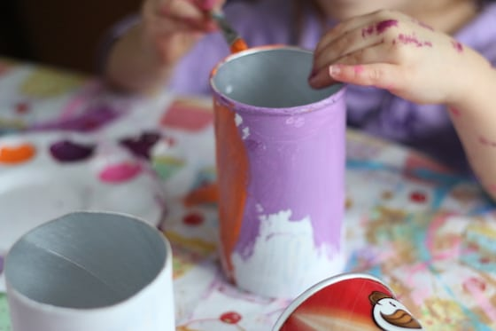 child painting Pringles can