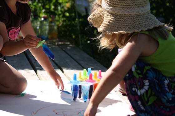 kids painting with homemade coloured ice pops