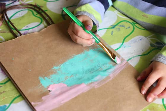 child painting paper bag