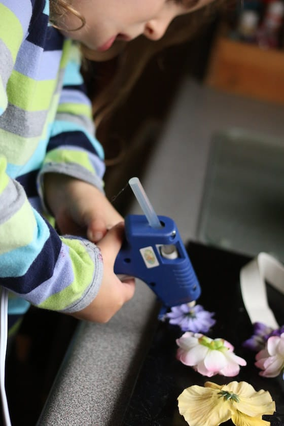 preschooler using low-heat glue gun