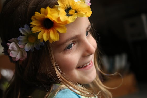child wearing homemade flowered tiara