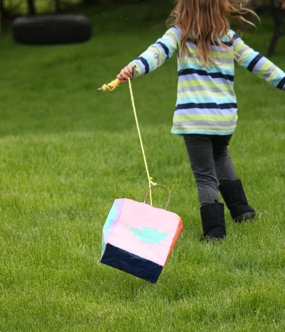 child running with homemade kite