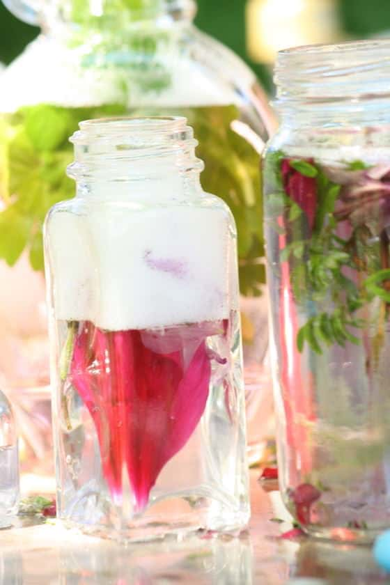 jars and bottles filled with perfume that the kids made