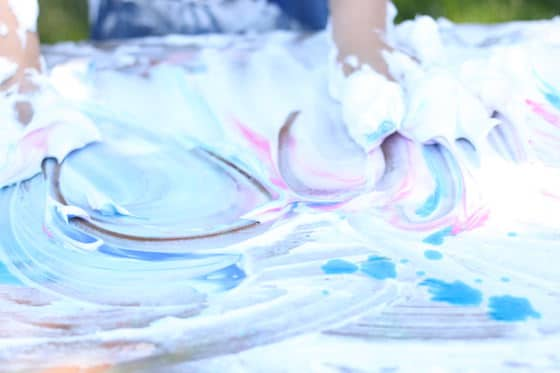 kids playing with shaving cream and food colouring