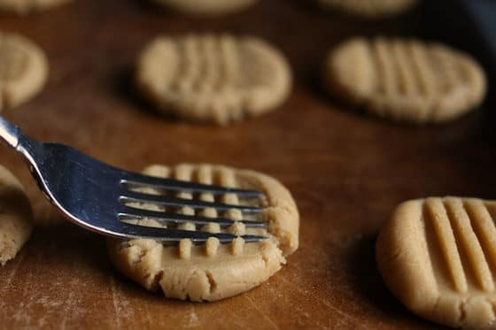 pressing peanut butter cookie dough with fork